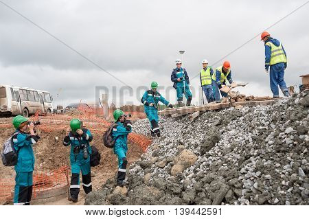 Tobolsk, Russia - July 15. 2016: Sibur company. Construction of plant on processing of hydrocarbonic raw materials. Photographers shoot workers on construction site