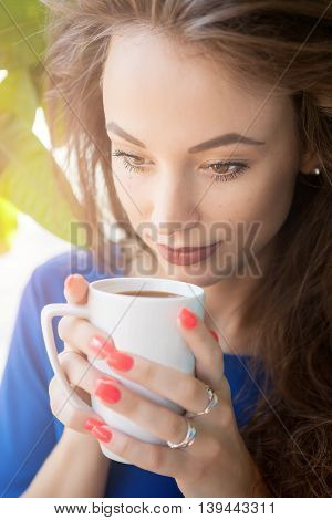 Girl Drinking Coffee In Close Up Photo