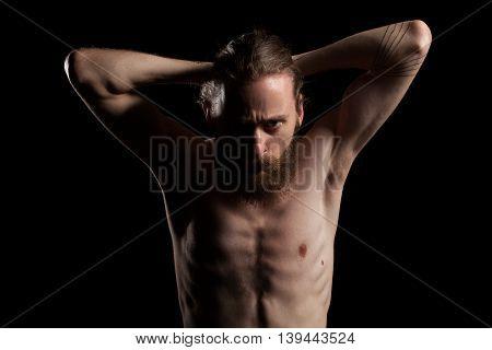 Cool Looking Bearded Man In Deep Shadows