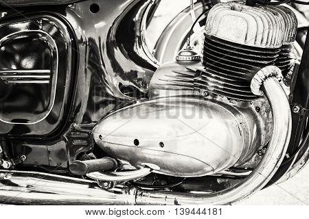 Detail of veteran motorbike. Meeting bikers. Black and white photo. Motor of motorcycle. Symbol of luxury lifestyle.
