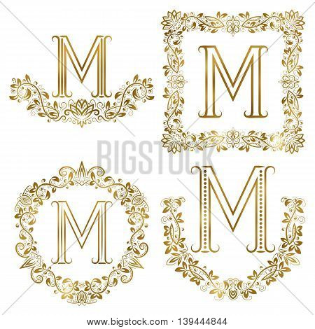 Golden M letter ornamental monograms set. Heraldic symbols in wreaths square and round frames.