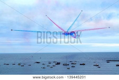 The Royal Air Force Red Arrows Display Team perform in Lyme Regis Dorset