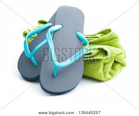 Flip flops and towel isolated on white background.