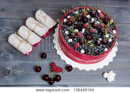 rose wedding biscuit fruit cake with berries and some green