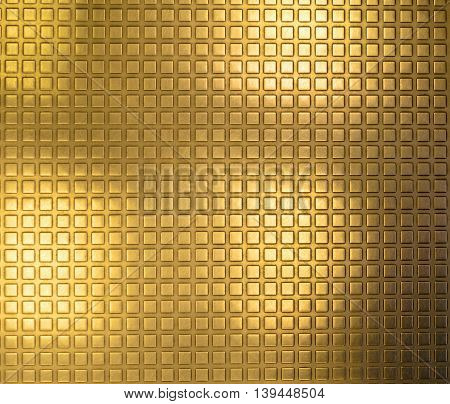 Shiny gold plated metal surface with a texture in the form of small convex squares