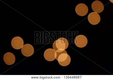 Abstract spotted background of group of orange circles on black