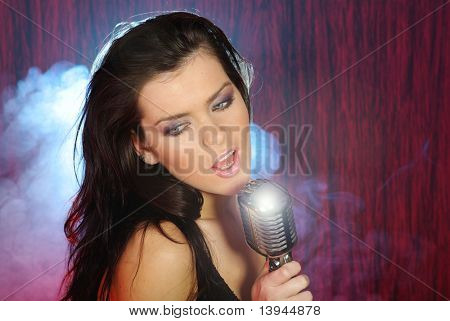 Singer .Sexy woman  singing in retro mic. music concert
