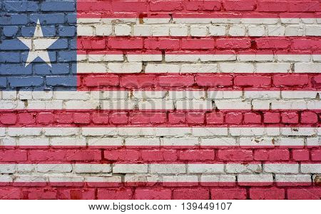 Flag of Liberia painted on brick wall background texture