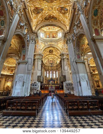 Bergamo Italy - February 23 2016: Interior of Basilica di Santa Maria Maggiore. The church is Romanesque architecture with a gilded interior hung with tapestries built in 1137.