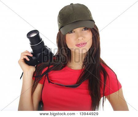 beautiful woman holding a photo camera. Isolated over white background