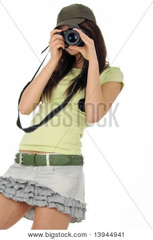 beautiful girl holding a photo camera. Isolated over white background
