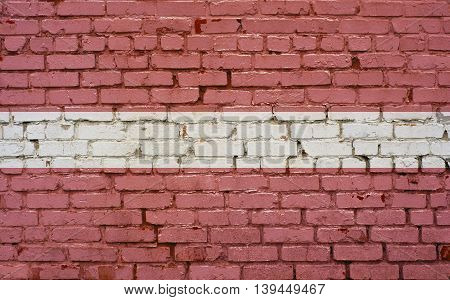 Flag of Latvia painted on brick wall background texture