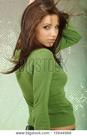 Glamour Portrait of sexy woman on green background