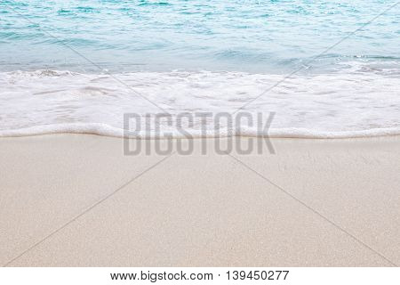 View of nice tropical beach with white sand and blue water