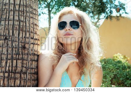 Portrait of young attractive woman having good time in summer environment
