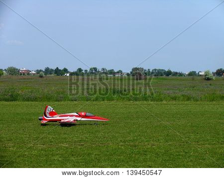 Model of a jet airplane on the remote control just landed on the grass