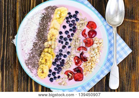 Smoothie with Blueberries, Chia Seeds on Brown Boards Studio Photo