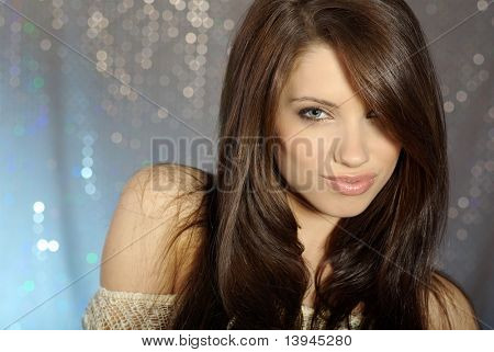 Glamour Portrait of sexy woman on blue background