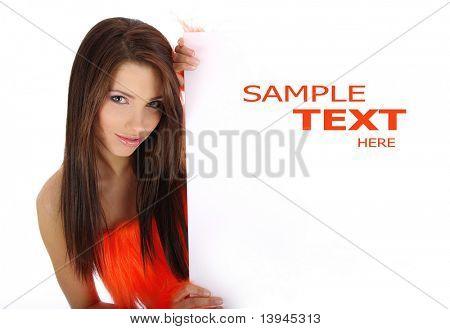 beautiful smiling girl in orange costume holding a blank billboard.
