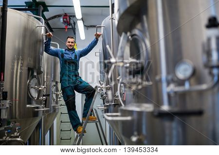 Portrait of happy maintenance worker at brewery