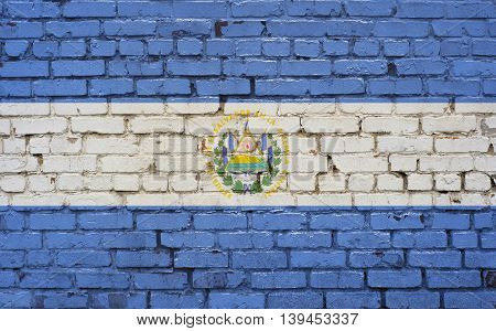 Flag of El Salvador painted on brick wall background texture