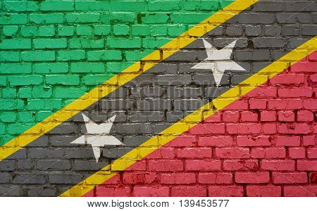 Brick wall with painted flag of St Kitts and Nevis