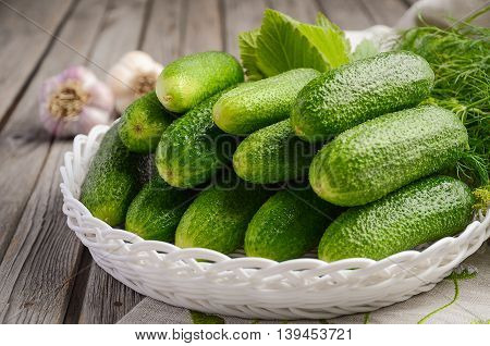 Fresh green cucumbers on wooden background, selective focus