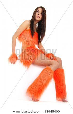 beautiful cheerleader in orange costume holding blank billboard
