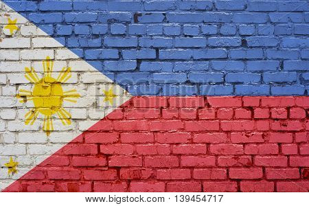 Flag of Philippines painted on brick wall background texture