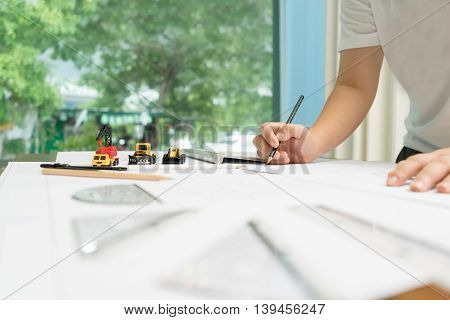 Business architect drawing on architectural project architectural concept soft focus