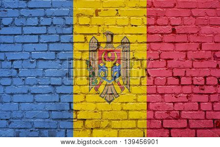 Flag of Moldova painted on brick wall background texture