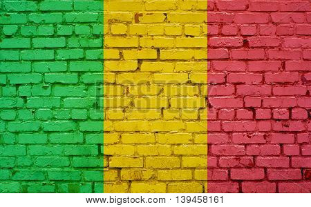 Flag of Mali painted on brick wall background texture