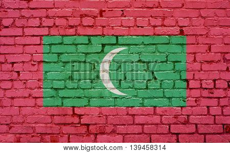 Flag of Maldives painted on brick wall background texture