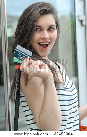 Woman Is Pleased To Get A Discount.