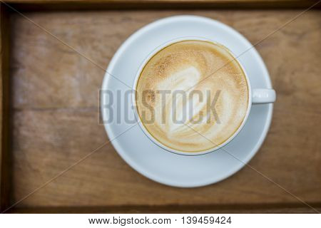 hot latte art on wood table background