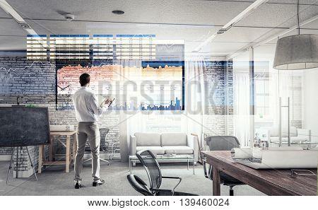 Businessman in modern interior  .  Mixed media
