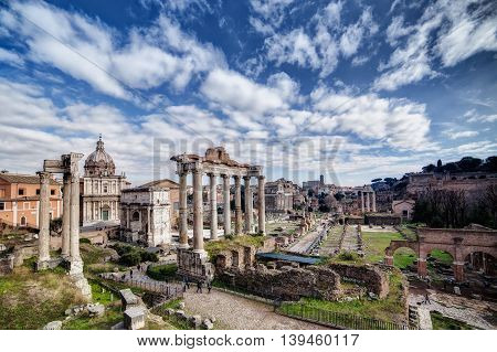 January panorama of Forum Romanum Rome Italy. Cold day with great sky and clouds over ancient ruins.