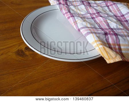 White Table And A Colored Cloth On A Table