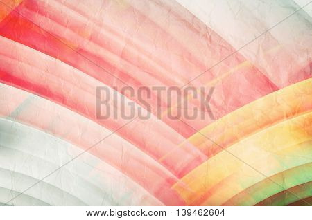 Abstract geometric background with colorful intersected circles over old paper texture