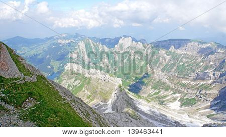 Mountain world in Switzerland, view from Säntis on the Alpstein-Massif with the Lake Seealp in the Appenzellerland, steep rocks and deep valleys,