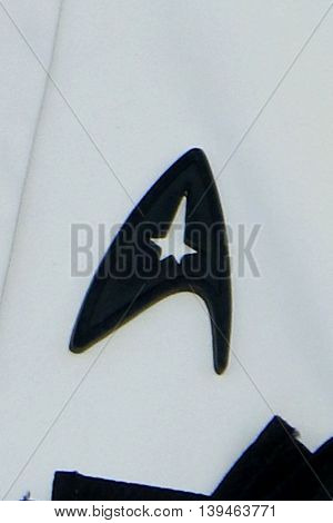 LOS ANGELES - JUL 20:  Simon Pegg's Black Starfleet delta badge worn in tribute to Anton Yelchin at the