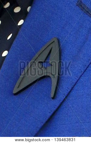 LOS ANGELES - JUL 20: Zachary Quinto's Black Starfleet delta badge worn in tribute to Anton Yelchin at the