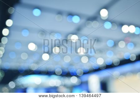 Defocused light and shadow of shopping mall blue tone abstract background