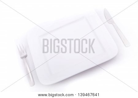 A blank plate with a knife and a fork.