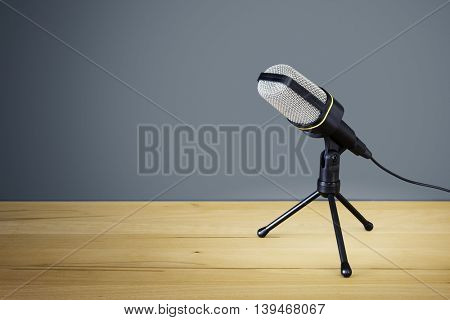 An image of a typical microphone on a wooden desk