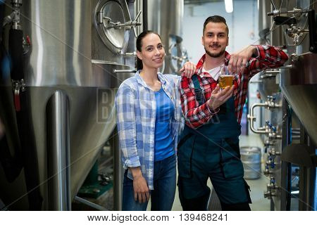 Portrait of brewers testing beer at brewery