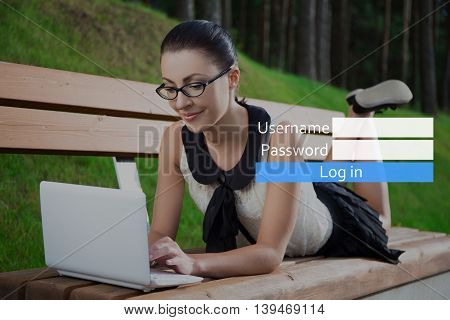 Internet Concept - Girl In School Uniform Using Laptop Lying On Bench In Park