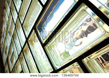 A glass brick wall background. Architecture interior.