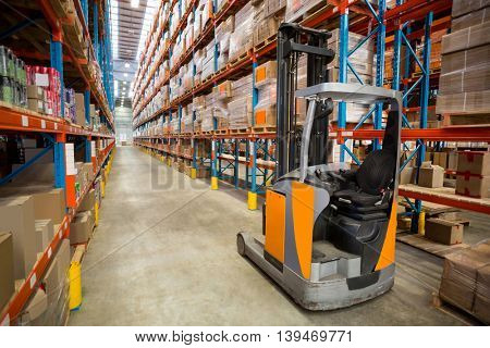 View of pallet truck and goods tidy in a warehouse