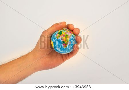 Man holding an earth globe in his hands